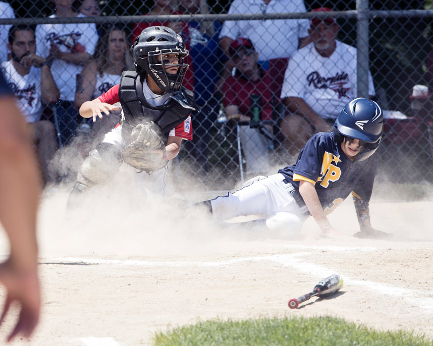 Riverside catcher Jose Figueroa watches for the ball as a North Providence player slides into home during the 12U All-Stars State Tournament game against North Providence, Saturday, July 24, in Cumberland.