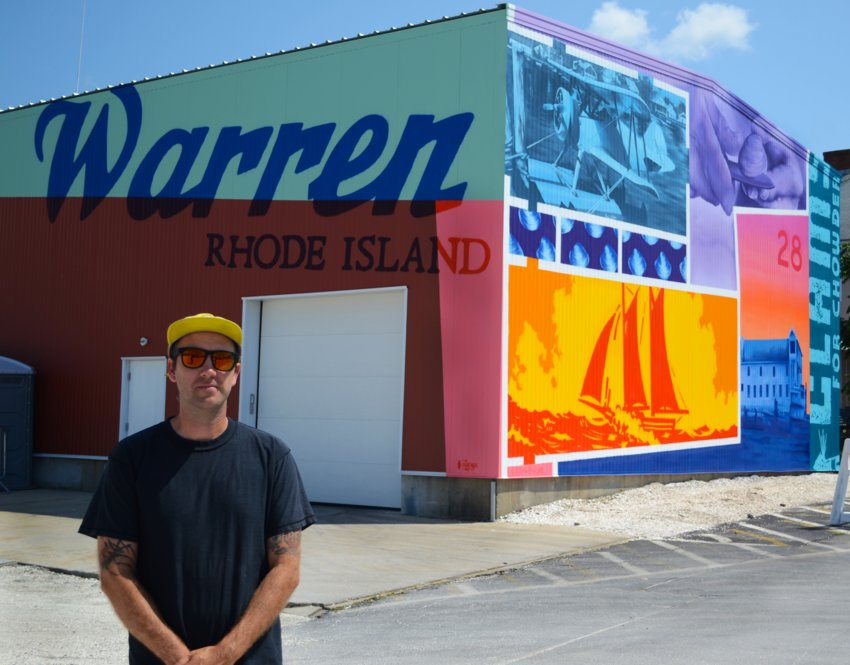 Greg Pennisten stands in front of his newly-finished mural, a spray-paint piece that celebrates the maritime history of Warren. It was commissioned by Blount Fine Foods in collaboration with The Avenue Concept.
