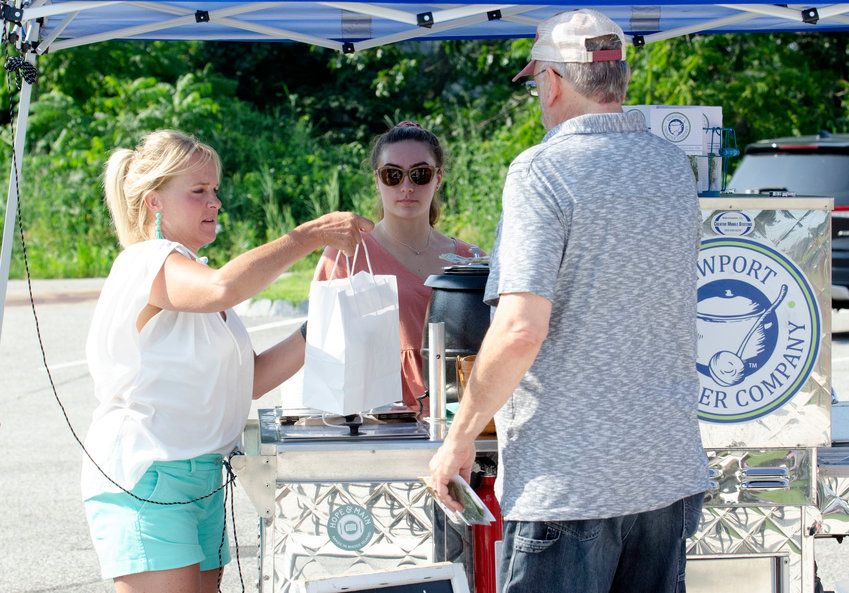 Katie Potter and daughter Sydney serve their Newport Chowder Company chowder at The Cove in Barrington, a recent Friday evening.