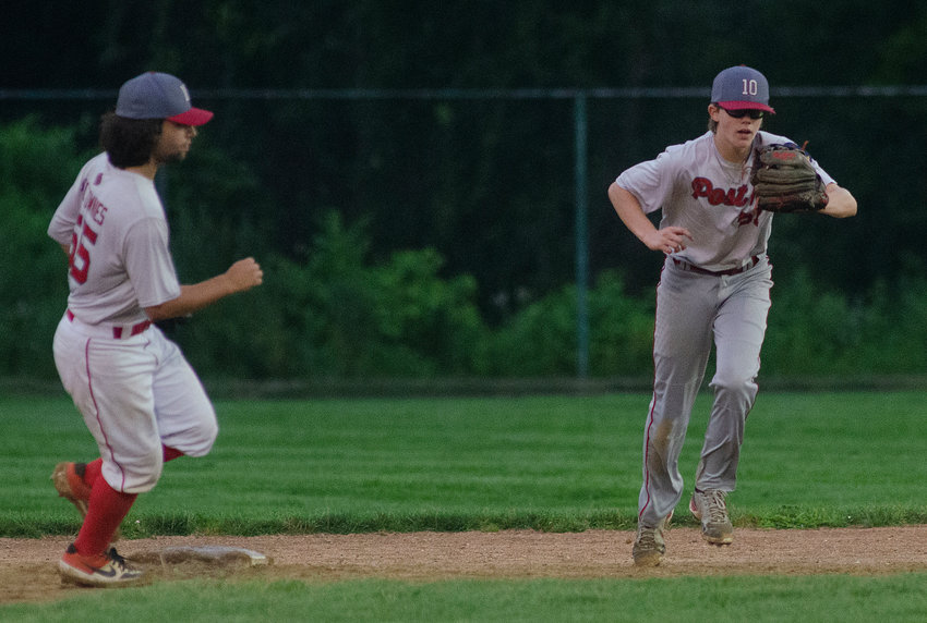 Riverside shortstop Oliver Andrews looks on as second baseman Brian Rutowski (right) snares a line drive to secure a victory over Scituate Thursday night, July 29.