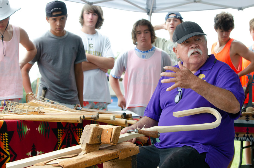 """Alfie Jacques, the """"Stickmaker of the Iroquois,"""" shares his craft with young participants in the Beach Dogs Lacrosse Camp at Glen Farm last week. Mr. Jacques, considered a legend in the field, has been making lacrosse sticks by hand for nearly six decades. He lives in New York but traveled to the camp to teach the Native American origins of the sport."""
