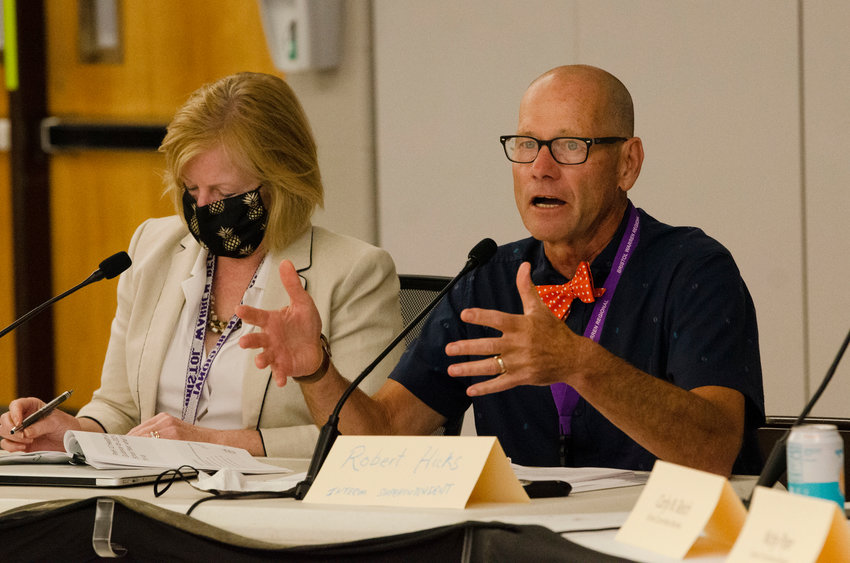 Interim Superintendent of Schools Robert Hicks, sitting beside Assistant Superintendent Diane Sanna, presentedhis reopening plan to the school committee back in August. A heated closed-door meeting with the committee on Monday night led to his sudden resignation.