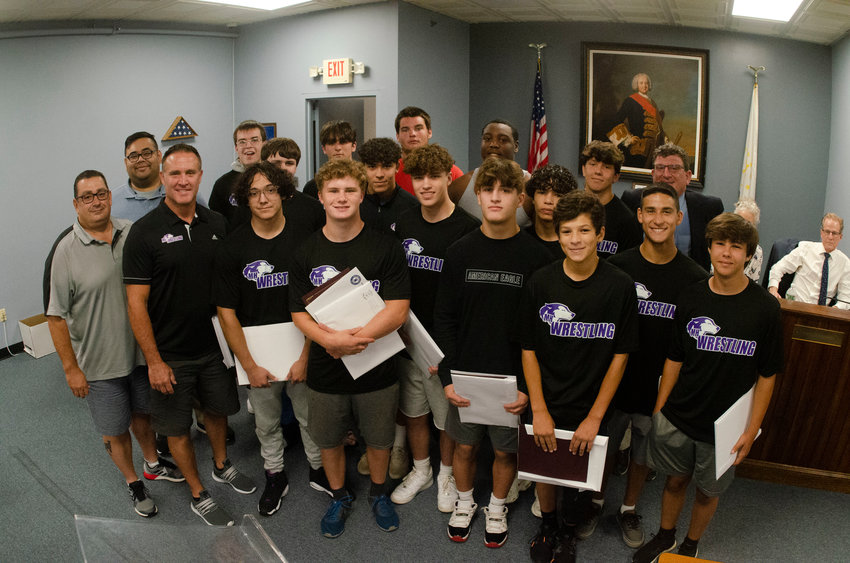The Mt. Hope High School mens wrestling team was celebrated for their championship season at the Warren Town Council meeting on Aug. 10