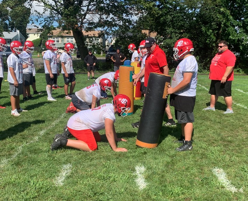EPHS head coach Jon Stringfellow works with his lineman group during preseason camp Tuesday, Aug. 24.