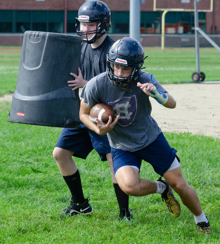 Barrington High School running back Bryan Ivatts carries the ball during a drill on the first day of fall preseason practices.
