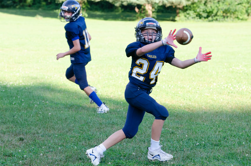 Barrington's Cole Fluet hauls in a pass during practice earlier this week. Barrington Pop Warner football teams open the fall season with games against Seekonk this Sunday at BHS's Victory Field.