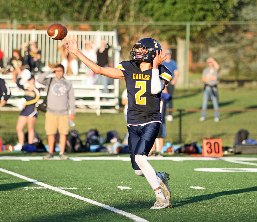 Barrington High School quarterback James Anderson throws a pass during first half action of the Injury Fund scrimmage against Middletown last Friday night.