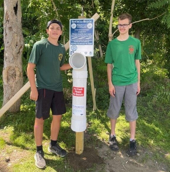Nathan Simas of Bristol with friend Nathan Dieterich. Simas built five fishing line receptacles as part of his Eagle Scout journey.