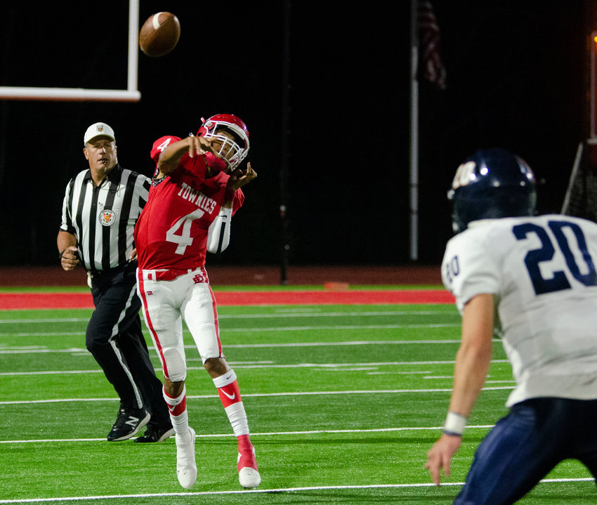 EPHS starting quarterback Max Whiting throws a pass for the Townies in their recent non-league outing against Barrington.