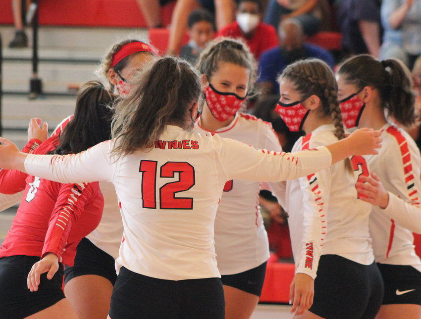 The EPHS girls' volleyball team celebrates a winning point during the Townies' first ever match inside the new gym Saturday, Sept. 11.