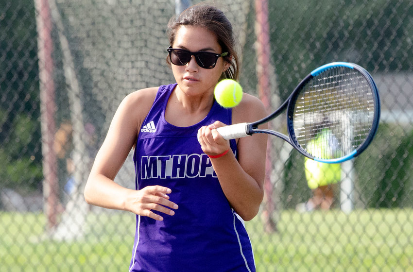 First singles player Elsa White hits a forehand during her match against South Kingstown on Wednesday.