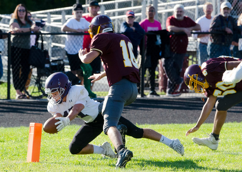 Sophomore cornerback Riley Howland dives into the end zone for a touchdown, after picking off Tiverton quarterback Ben Sowa, in the second quarter of an injury fund game last Friday night.
