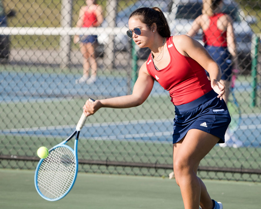 Talus Nightingale, the Patriots' No. 1 singles player, rallies with Narragansett opponent Olivia Lonkart on Friday. Talus won, 6-1, 6-2.