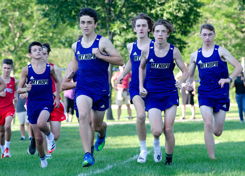 Jacob Detres, Sam Merriam, George Piper, Owen Schenk and Declan Reed race up field during the start of their cross country dual, home meet at Bristol Town Beach on Monday 9/13.