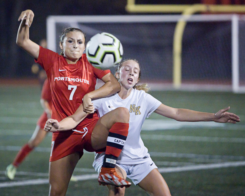 Taylor Barnaby battles a North Kingstown opponent for possession of the ball during Friday night's game at home.