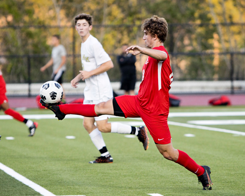 EPHS's Andrew Jackson settles a pass at midfield during the Townies' victory over North Kingstown earlier this season.