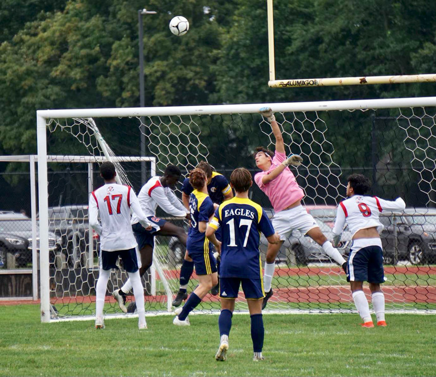 Barrington High School keeper JT Celico saves a tough shot with a punch over the crossbar against Central Falls. Barrington has opened its conference schedule with five straight wins.