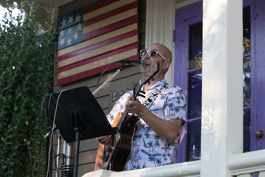 Bristol's Andre Arsenault sings and plays guitar on the porch at 142 High St. The popular Porchfest event brought an estimated 4,000 people to lower High Street on Sunday.