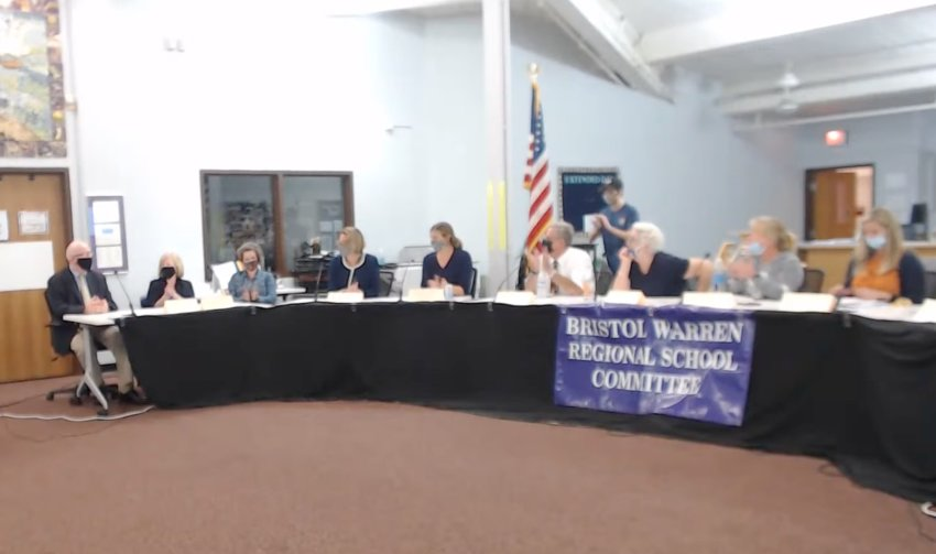 The Bristol Warren Regional School Committee gives a short round of applause after unanimously approving Ed Mara (seated at far left) as its new interim superintendent of schools Tuesday night.