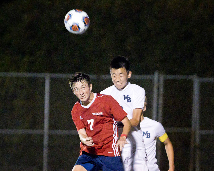 Portsmouth's Noah Phelan (left) and a Moses Brown opponent vie for a throw-in pass during a home game won by the Patriots on Wednesday, Sept. 22.