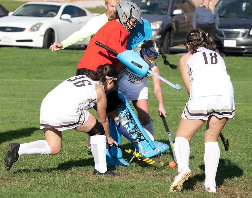 Emma Bessette (left) Brooke Legendre and Ava Rodrigues attack the Hawks goalkeeper, after a Kyra Ferreira shot on goal.  Westport won the game, 5-0 and is currently 5-2-1 in the Mayflower Athletic Conference.