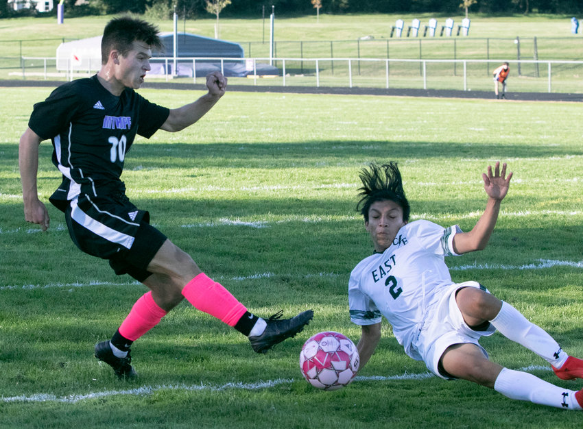 Midfielder, Nick Andreozzi, boots a shot on goal in the first half of the team's game against East on Friday night. Mt. Hope won, 4-1. Andreozzi is sixth in scoring in Division II, with 3 goals and 3 assists for 9 points.