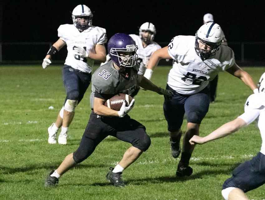 Running back Brock Pacheco runs for a first down in the second quarter of the team's home game against Westerly on Friday night. Pacheco ran for 23 yards and also had 23 receiving yards.