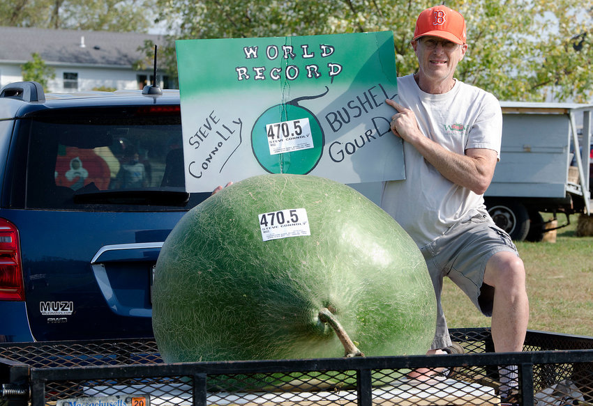 Steve Connolly with his world record bushel gourd, which weighed in at 470.5 pounds and crushed the prior record by over 100 pounds at last year's weigh-off.