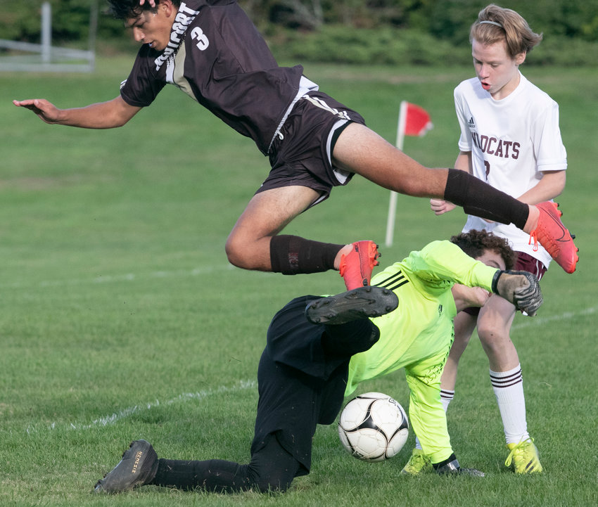 Midfielder, Antonio Dutra-Africano is upended by the West Bridgewater goalkeeper as he attempts to score in the second half.