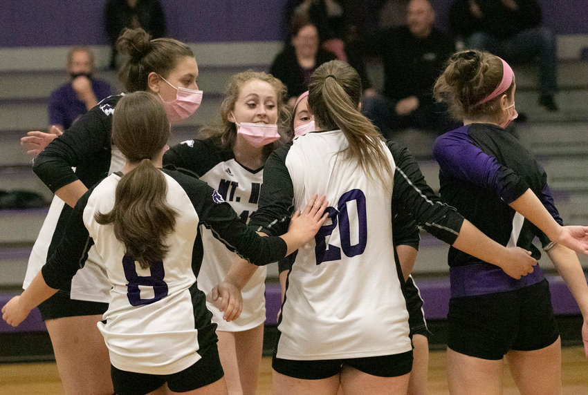 Emma Torres (left), Abby Adams, Jillian Brown, Sammy Malafronte, Grace Stephenson and Erika Tally, rally after a Huskies point.