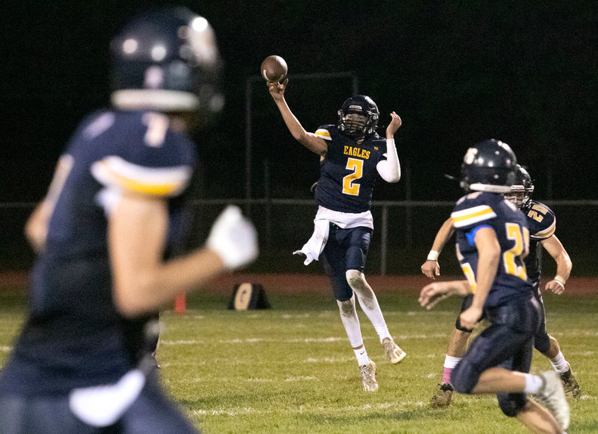Barrington High School senior quarterback James Anderson releases a pass during the Eagles' win over Rogers on Friday night.