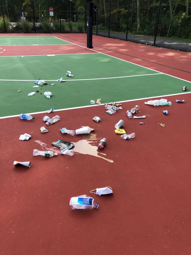 Town officials said there is hardly a day that goes by where the court is not covered with empty water bottles, soda cans, disposable face masks, food wrappers, pizza boxes and other debris.