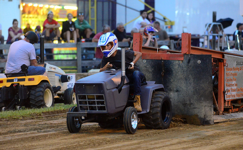 Liam Sylvia, 14, of Westport, revs up his tractor during the D Stock Division tractor pull at the Westport Fair in 2019.