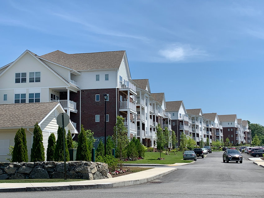A view looking at a row of apartment buildings inside the Kettle Point development.
