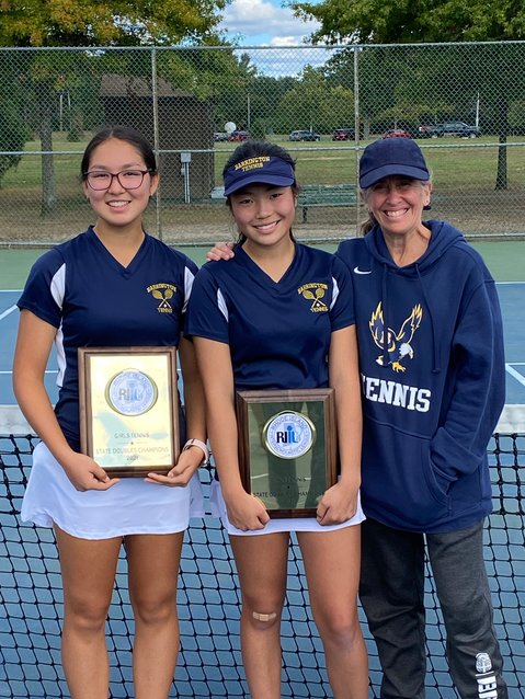 Barrington High School girls tennis coach Betsy Brenner (right) stands with the state championship doubles team of Ava Koczera-Kasem (left) and Katie Byon following the finals this weekend. Singles player Kate Robertson reached the semifinals of the state singles tournament.