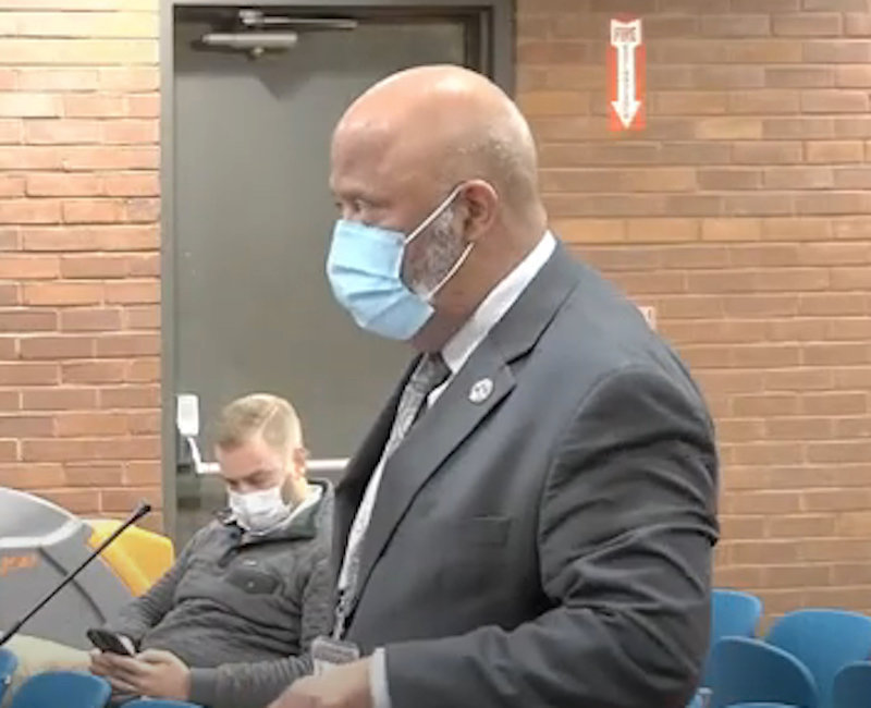 Director of Administration Napoleon Gonsalves wears a mask for a time, later discarding it to speak, during his remarks before the City Council at its October 19 meeting.