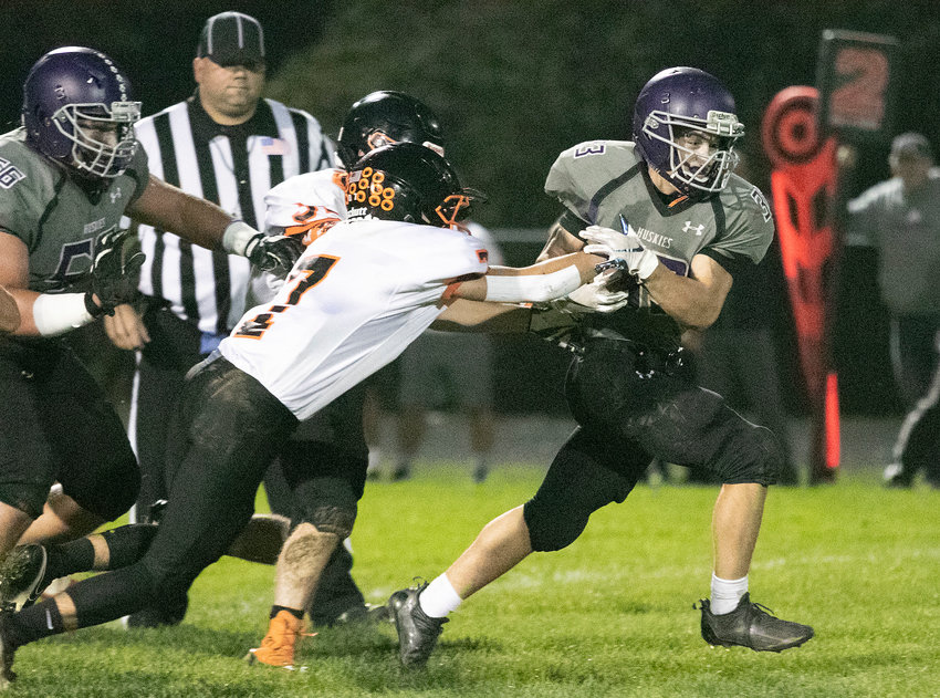 Brock Pacheco sheds a tackle for a big gain in the first half.