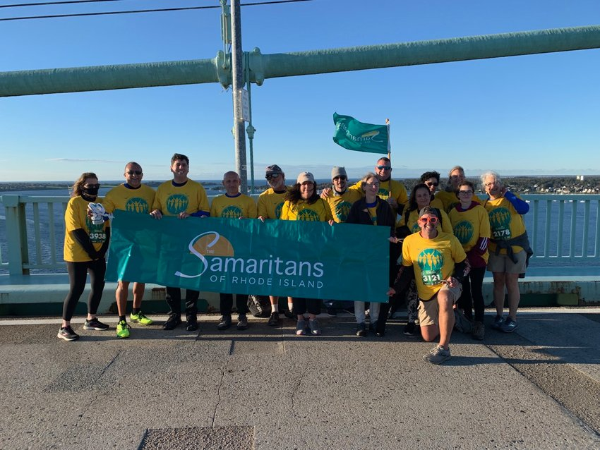 The Samaritans Team gathers for a photo on top of the bridge at the Pell Bridge Run, held Sunday, Oct. 17. The group includes barrier advocates Sen. Louis DiPalma and Rep. Joseph Solomon, as well as Melissa Cotta and Bryan Ganley of Bridging the Gap for Safety and Healing.