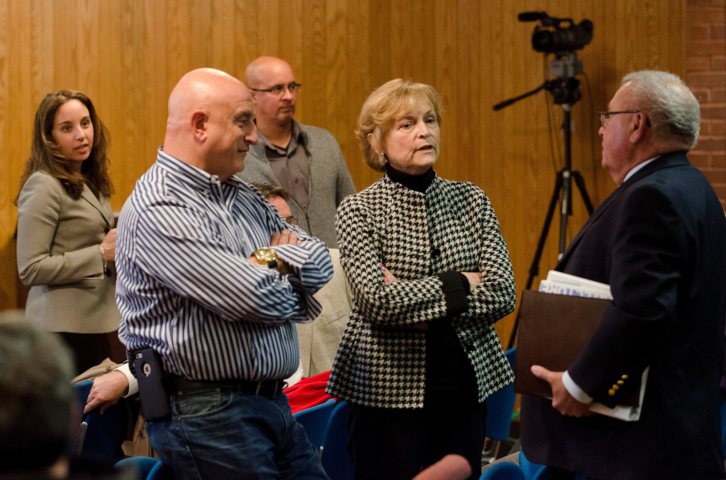 Facilities director Tony Feola, superintendent Kathryn Crowley and former superintendent Manny Vinhateiro have a discussion during the school committee's special session Monday.