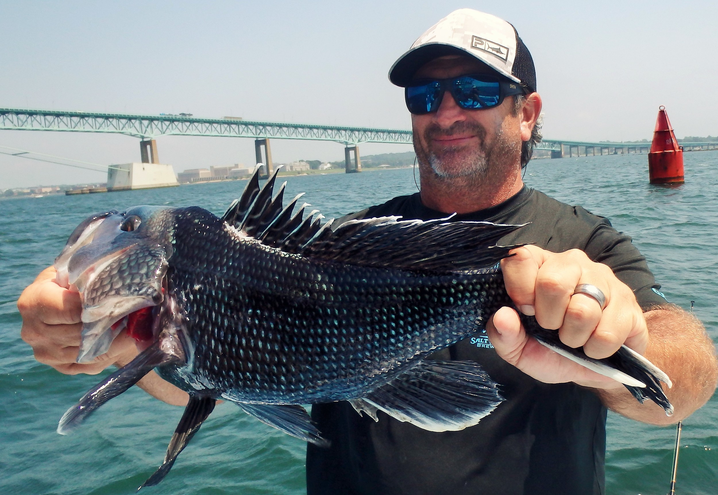 Newport black sea bass bite was good for Joe Roth of Boca Raton, FL who fished the bridge area with success Wednesday. He and wife Linda were fishing with cousin Kevin Fetzer of East Greenwich.