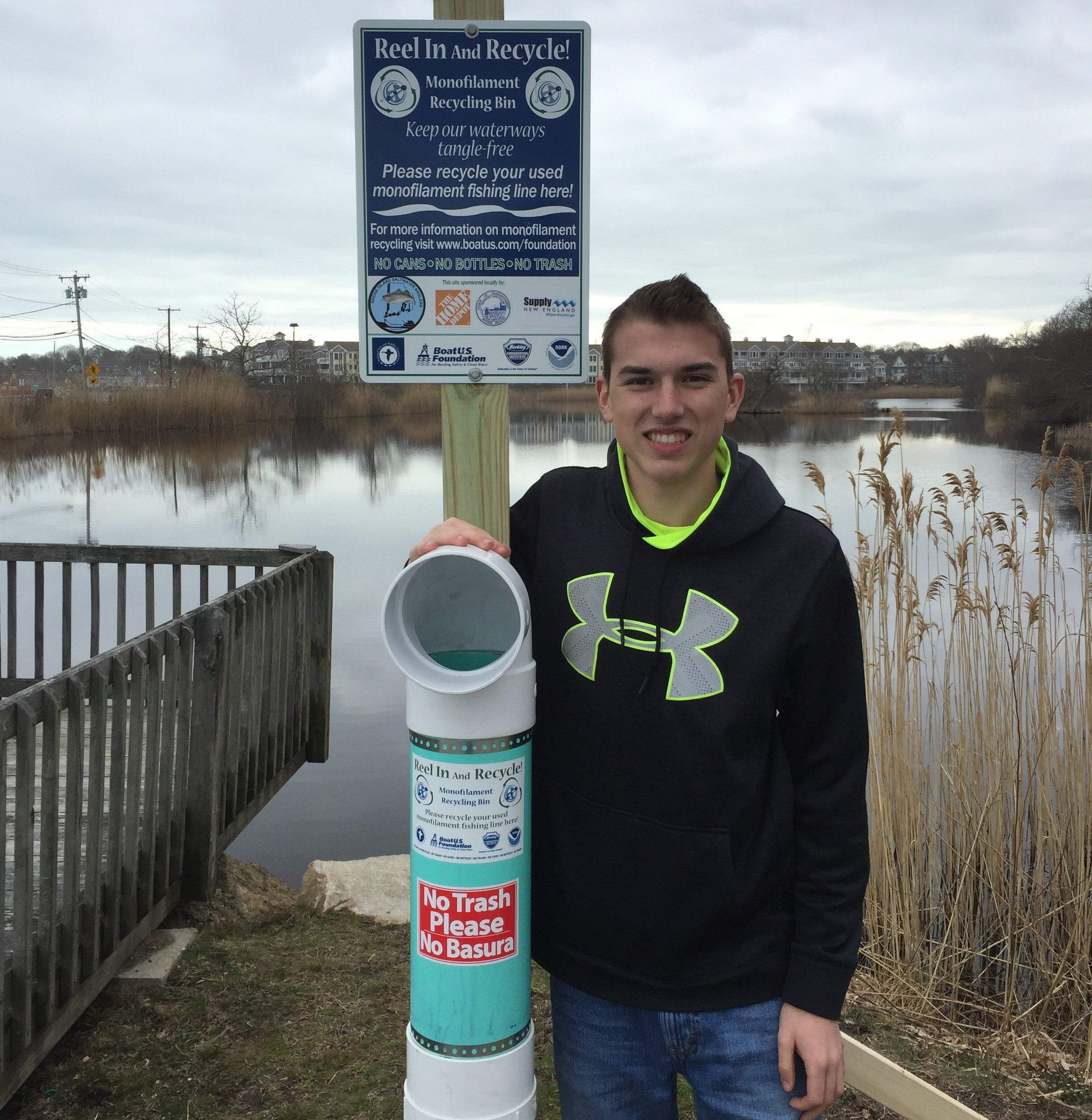 Noah Tellier of with one of the fishing line collectors he designed, built and helped install at three South County fishing areas.
