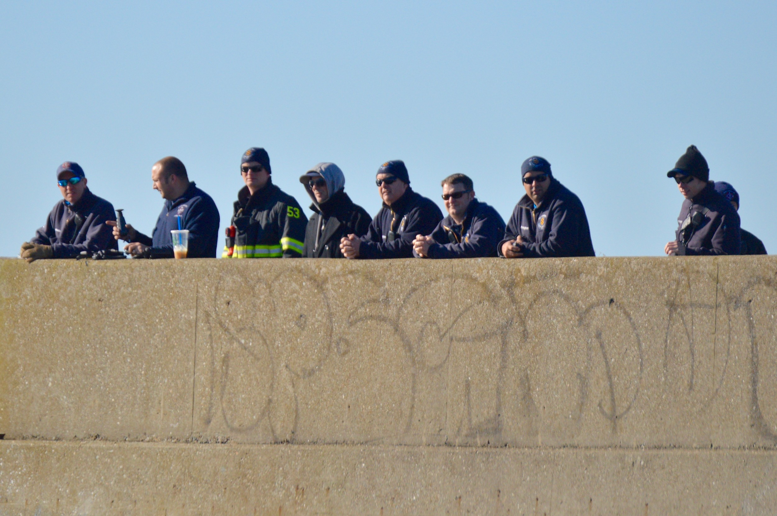 First responders observe the rescue drill from the end of the Portsmouth side of the Stone Bridge abutment.