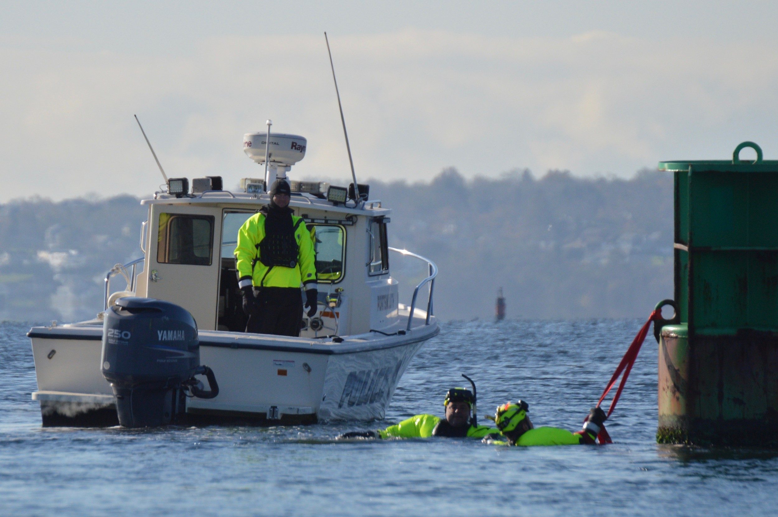 Portsmouth Firefighter Dennis Canario swims toward Lt. Andrew Jones, playing a swimmer in distress who was holding on to a cord attached to a channel marker in the Sakonnet River.