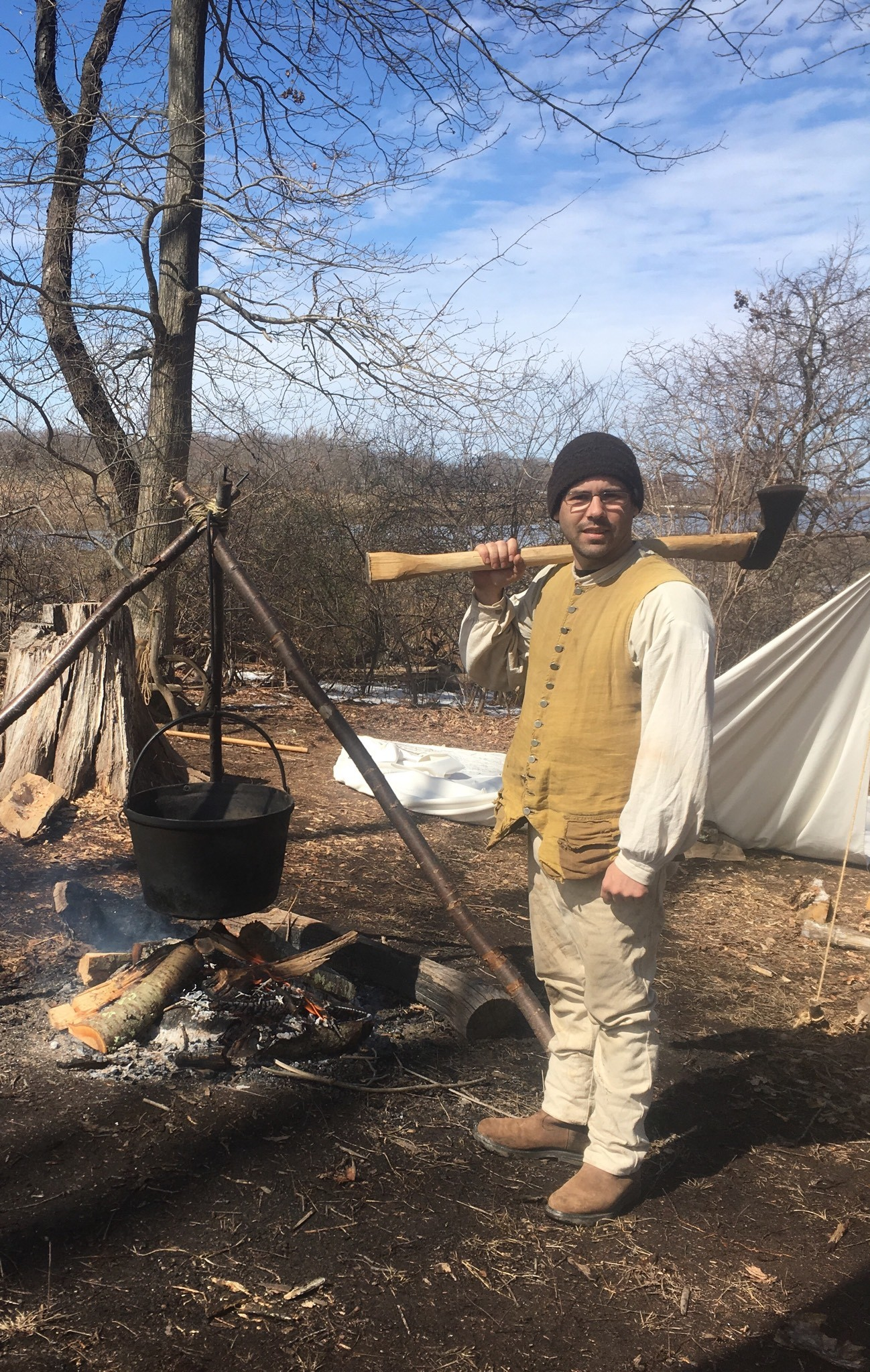 Todd Stevens tends the fire at Coggeshall's maple sugaring camp.