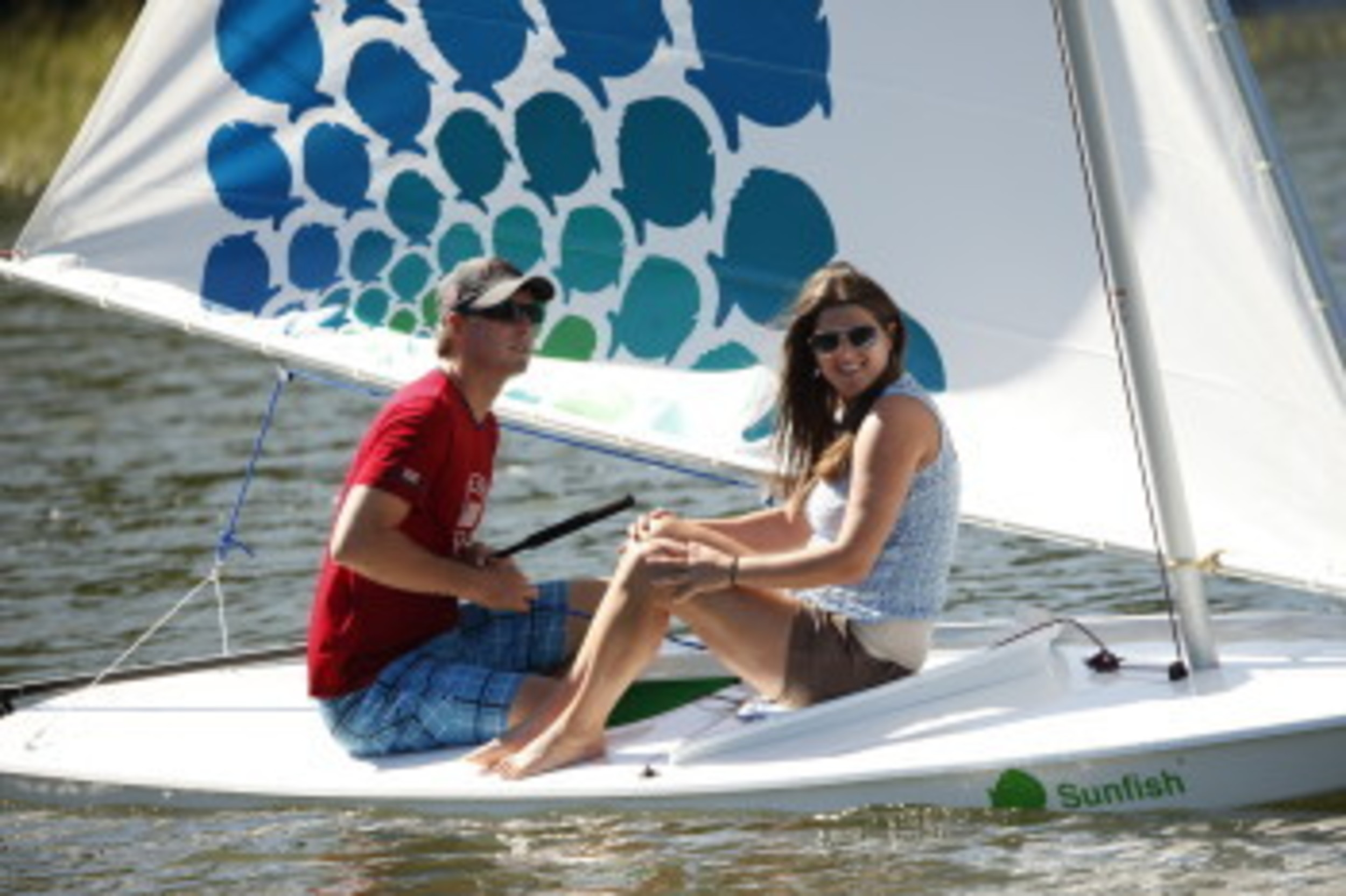The 60th anniversary Sunfish sports a whole school of the little round fish on its sail.