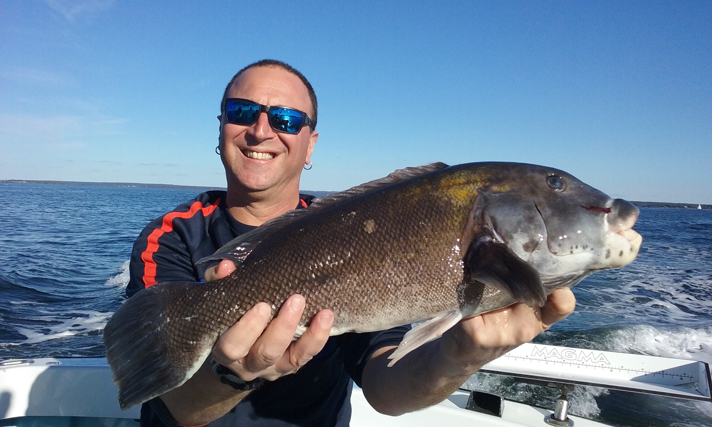 Steve Brustein of Portland, Maine (and West Warwick) with a spring tautog caught with a green crab at General Rock, North Kingstown in the West Passage of Narragansett Bay.