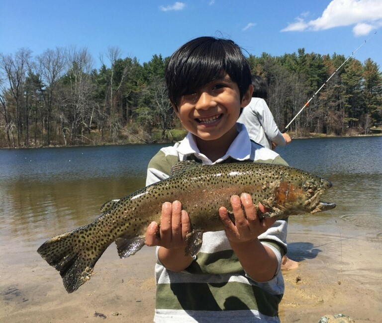 Benjamin Hernandez (five years old) with a rainbow trout he caught this week.