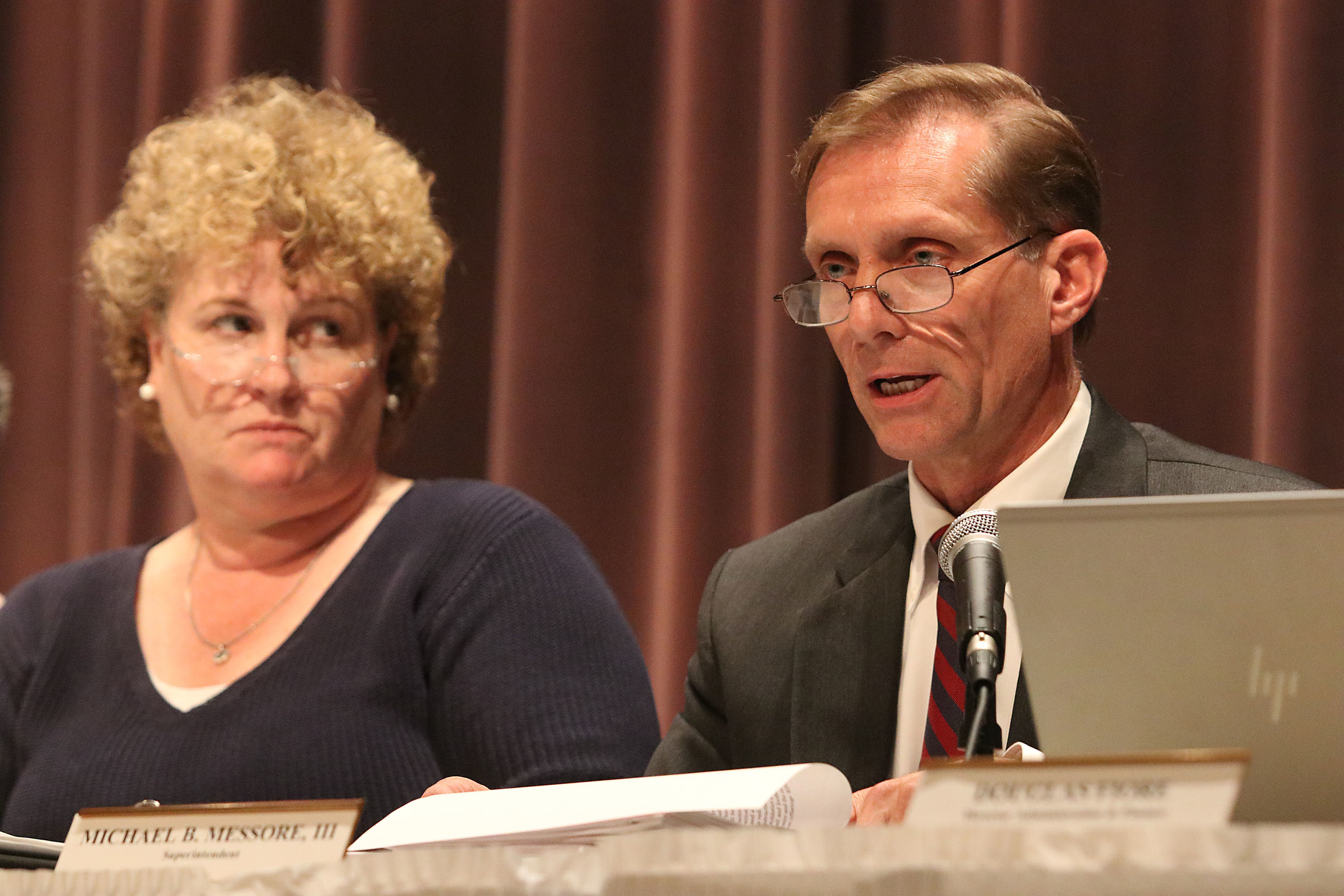 Barrington Superintendent of Schools Michael Messore answers a question from the audience during a public hearing earlier this year. School Committee member Anna Clancy looks on.