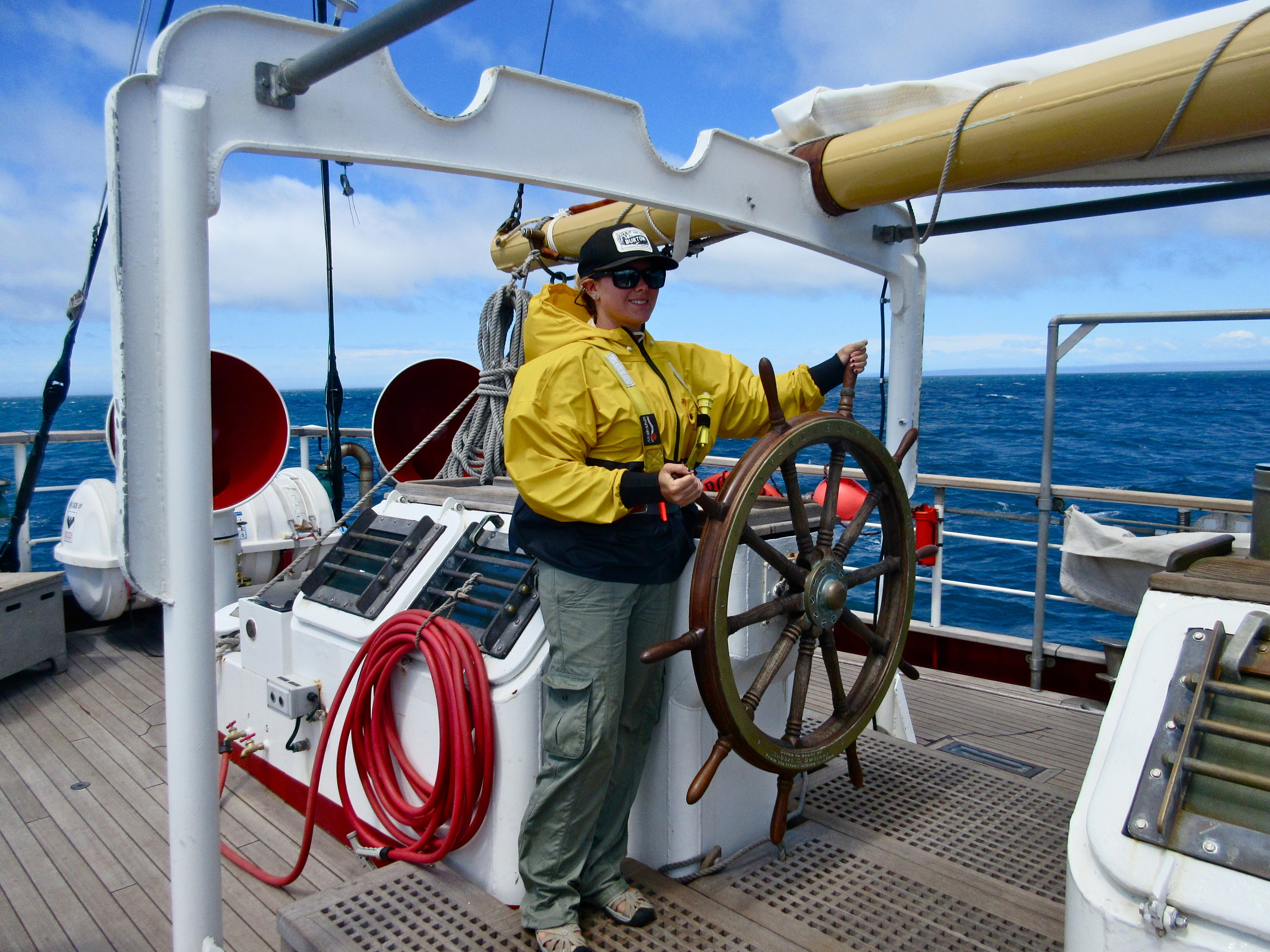 Manning the wheel during a Sea Education Association trip to New Zealand in 2014.