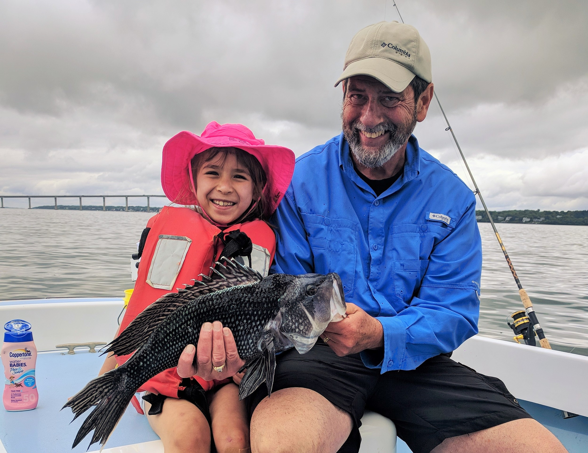 "Lucia Wong (7) of Cambridge caught and released black sea bass to 22"" this week fishing south of the Jamestown Bridge with Capt. Dave Monti."